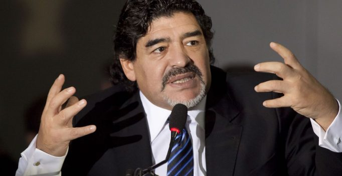 """Football legend Argentinian Diego Maradona gestures during a press conference on February 26, 2013 in Naples. Maradona, who rarely stepped foot in Italy since leaving under a cloud in the 1990s amid claims of collusion with mafia dons and a positive drugs test for cocaine, asked for """"justice"""" in his dispute with Italian tax authorities on an emotional trip to Naples -- the scene of some of his greatest career successes.  AFP PHOTO / CARLO HERMANN        (Photo credit should read CARLO HERMANN,CARLO HERMANN/AFP/Getty Images)"""