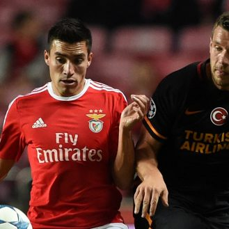Benfica's Argentinian midfielder Nico Gaitan vies with Galatasaray's Germany forward Lukas Podolski during the UEFA Champions League football match SL Benfica vs Galatasaray AS at the Luz stadium in Lisbon on November 3, 2015.   AFP PHOTO / FRANCISCO LEONG        (Photo credit should read FRANCISCO LEONG/AFP/Getty Images)