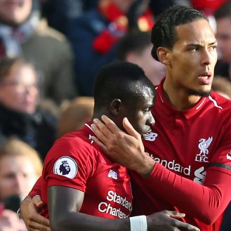 LIVERPOOL, ENGLAND - FEBRUARY 09:  Sadio Mane of Liverpool celebrates after scoring his team's first goal with teammate Virgil van Dijk of Liverpool during the Premier League match between Liverpool FC and AFC Bournemouth at Anfield on February 9, 2019 in Liverpool, United Kingdom.  (Photo by Alex Livesey/Getty Images)